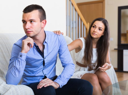 the spouse: Offended adult american person rejecting trials of spouse to reconcile Stock Photo