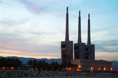tall chimney: power plant in evening time