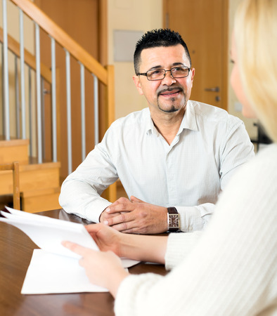 come home: Female social worker has come home to a man to fill in a survey questionnaire Stock Photo