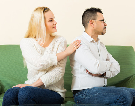 fracas: Loving woman tries reconcile with despair man after quarrel. Focus on guy Stock Photo