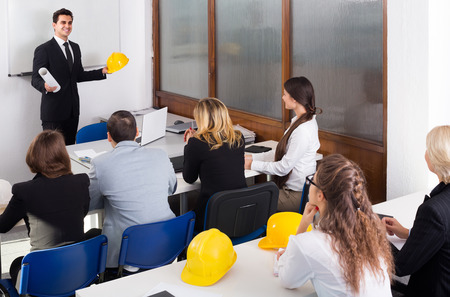 courses: positive european architects having advanced training courses in classroom Stock Photo