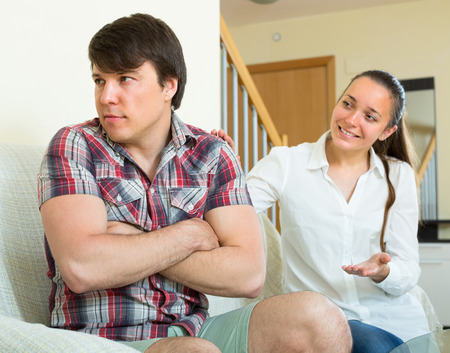 to reassure: Young woman tries to reconcile with man after quarrel