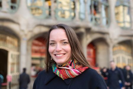 Portrait of female tourist with Casa Batllo  in background. Barcelona, Spain