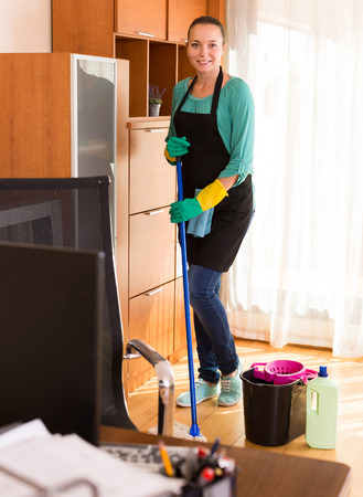 household tasks: european professional cleaner  cleaning the office