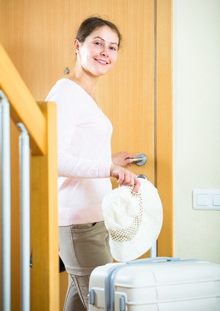 interphone: Adult brunette with baggage ready to leave for vacation Stock Photo