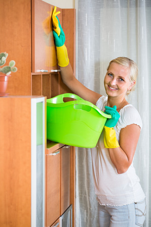 cleanup: Positive female doing regular clean-up at home Stock Photo