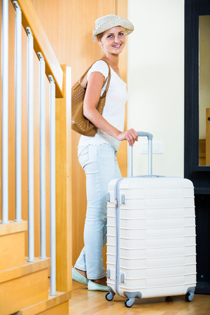 interphone: Portrait of young female traveller going at holiday trip Stock Photo