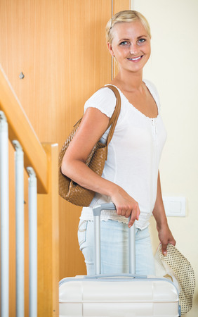 interphone: Portrait of young spanish female traveller going at holiday trip Stock Photo