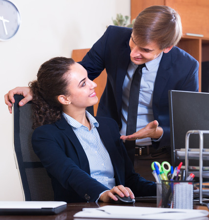 Sexual  harassment boss flirting with manager indoors