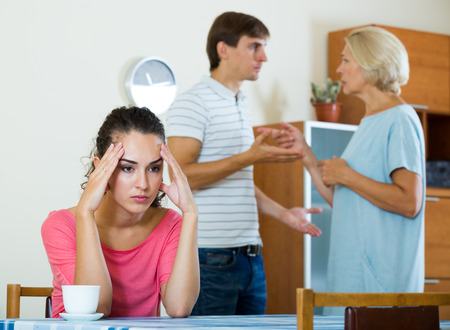 squabble: Upset girl apart from her husband and senior mother quarrelling Stock Photo