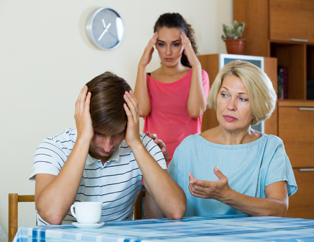 squabble: Adult guy having argue with wife and mother-in-law