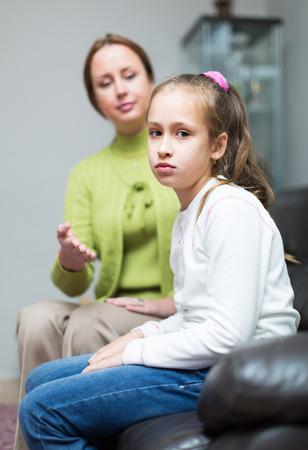 lament: Woman berating daughter in home interior