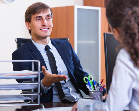 professional practice: Young american professional teaching new employee in practice at company Stock Photo
