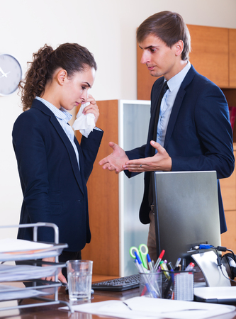 Dissatisfied adult manager arguing with subordinate official in office Stock Photo