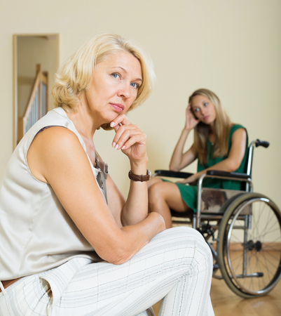 incapacitated: Communication problems between woman in wheelchair and female relative