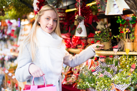 celebratory: Portrait of female customer near counter with Christmas celebratory gifts Stock Photo
