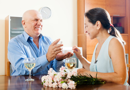 jewel box: Happy mature man giving  woman the jewel box  at home Stock Photo