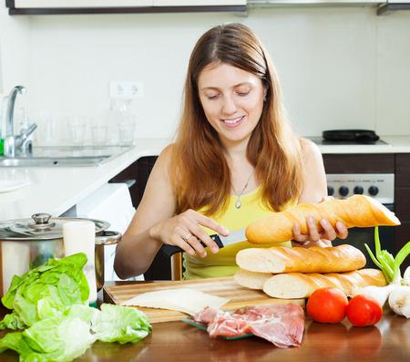 kitchen spanish: Girl cooking spanish sandwiches  in home kitchen Stock Photo