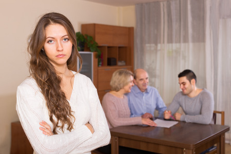 look after: unhappy adult girl with injured look after family quarrel Stock Photo
