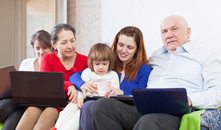 multigeneration: multigeneration family  together with few electronic communication devices