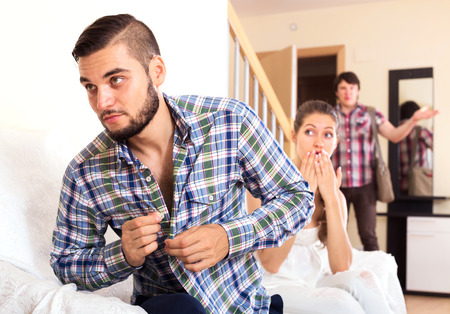 unfaithfulness: Husband watching how partner is cheating on at home