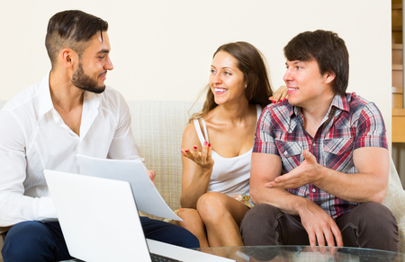 salesperson: Young happy  salesperson try hard to sign a contract with merried couple
