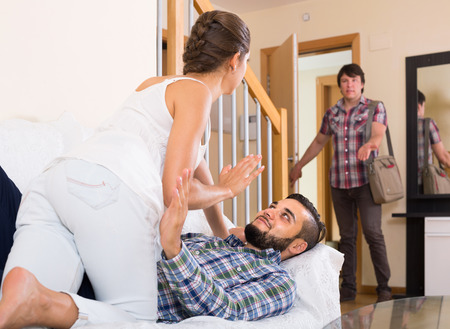 cheater: Jealous husband watching spouse flirting with friend at home