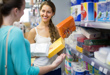 sudarium: Happy adult girls in good spirits selecting napkins in store Stock Photo