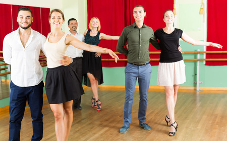 merry dancers: adult american group of people have fun while dancing waltz Stock Photo