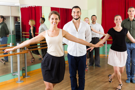 merry dancers: young group of people have fun while dancing waltz Stock Photo