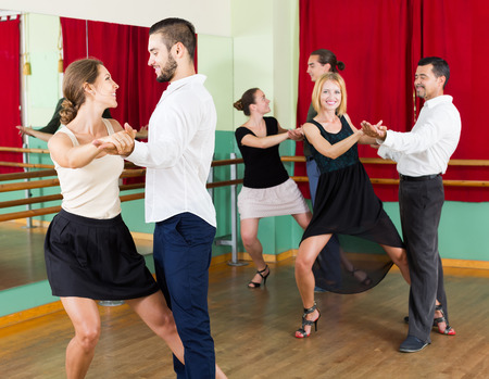 tango: adult european men and women enjoying of tango in class