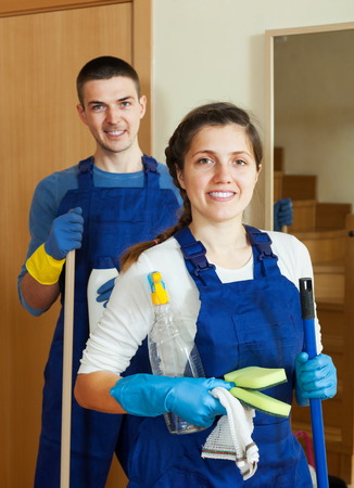 houseman: Handsome cleaners team at door at home