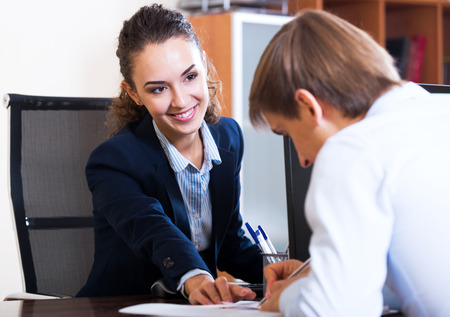 Happy hr manager inreviewing competitor for avalible vacancy Stock Photo - 49216844