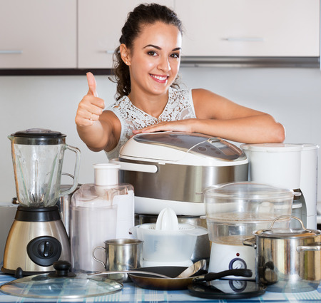 appliances: Happy housewife with kitchen appliances in the home Stock Photo