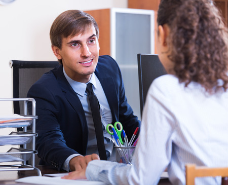 professional practice: Young professional teaching new employee in practice at department Stock Photo