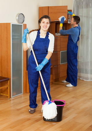 houseman: Ordinary cleaners cleaning living room at home Stock Photo