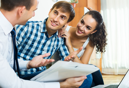 spouses: Happy spouses and positive salesman with documents