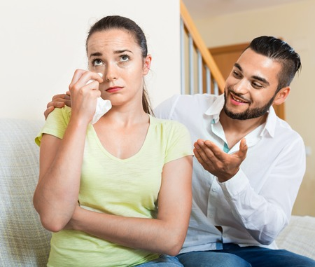 resent: Young man talking to upset nervous woman Stock Photo
