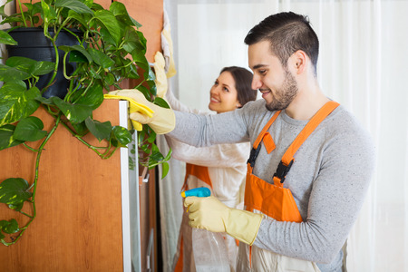 houseman: Portrait of cleaning premises team is ready to work in room