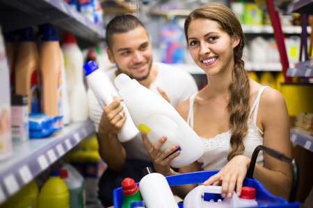 european people: Young european  people choose some detergents in the shop