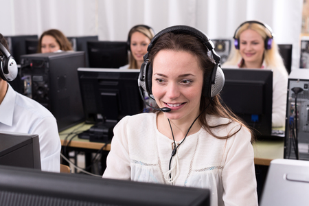 on call: Working process of successful call center team at office and smiling woman