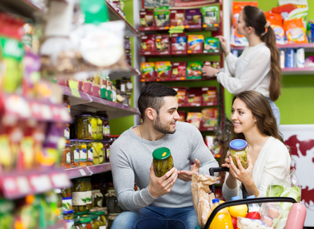 vegetable tin: People purchasing the food for week at supermarket Stock Photo