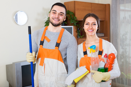 houseman: team of professional cleaners cleaning in room