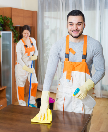 houseman: Cleaning premises happy team is ready to work in room