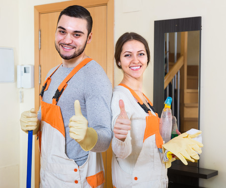 houseman: Professional cleaners washing in room
