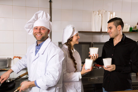 house robes: Positive customer, chef and cook at fastfood place