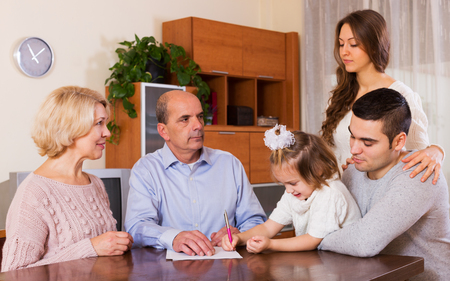 grand father: serious family members with bills and without money Stock Photo