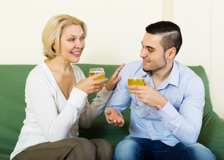 congratulating: Adult son congratulating mature mother and proposing a toast Stock Photo