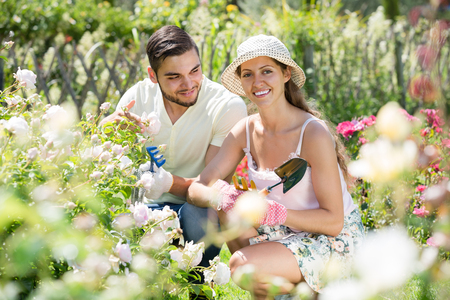 floriculturist: happy family of two spends their summer vacation in the country