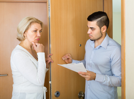 avarice: Businessman trying to collect arrearages from mature blonde woman